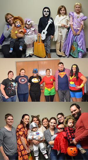 Employees and kids dressed in Halloween costumes